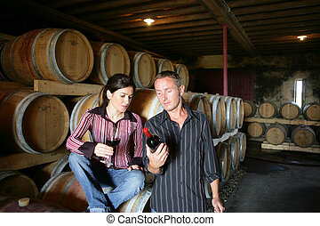 Winemakers drinking wine in a winery