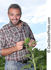 portrait of a man with plant