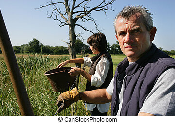 Farmer and wife in field