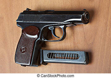 russian 9mm handgun PM (Makarov) on the table with holster,...