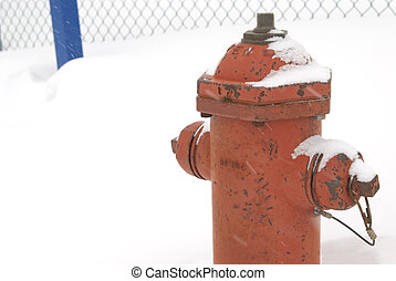fire hydrant - This is a red fire hydrant in a snow storm.