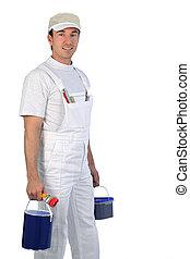 Male painter carrying paint pots