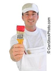 Decorator holding paintbrush
