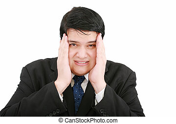 Close-up of a businessman with a migraine holding his temples.