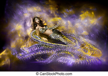 Beautiful woman in fantasy dress. Snake fashion dress...
