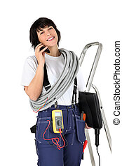 Female electrician making telephone call