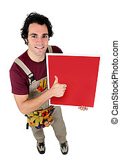 craftsman holding a red painted board