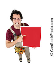 Handyman pointing to a red sign