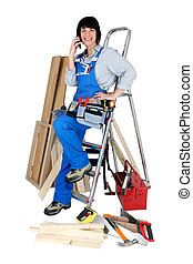 Tradeswoman talking on her mobile phone