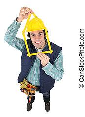 high angle shot of craftsman holding folding meter