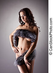 Young naked woman stand relaxed in fur - Beauty nude girl...