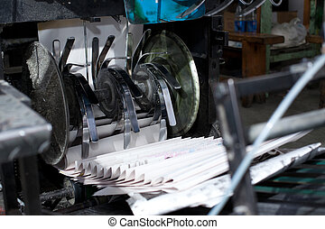 ready newspaper on production line in a print shop - ready...