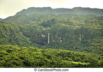 Mystic Jungle - Large waterfall in the middle of a...