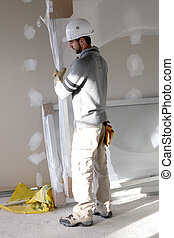 Man carrying sheet of plaster board