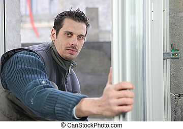 Man installing windows