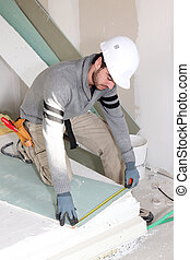 Man installing wall panels