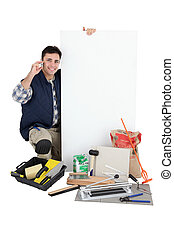 craftsman holding an ad board and talking on the phone