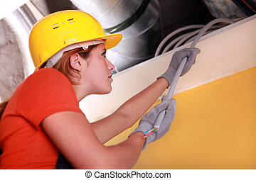 Female electrician at work