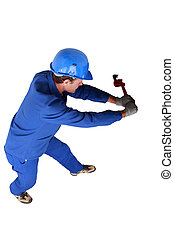 Top view of a plumber wrestling with a large wrench and...
