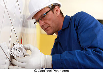 Electrical engineer fixing socket