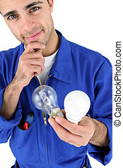Electrician holding light bulbs