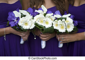 bridesmaids with flower bouquets - bridesmaids holding...