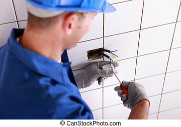 Electrician fitting a electrical point