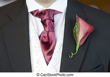 man with cravat and buttonhole flower - man with red cravat...