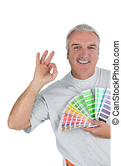 a man taking paint sample cards
