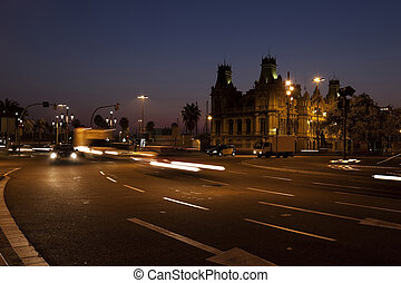 Nightscene in Barcelona, with vehicles on street with motion...