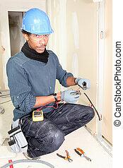 electrician taking measurements