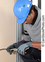Electrician repairing electrical wires