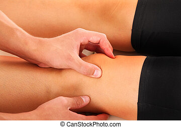 Knee therapy - A picture of a physio therapist giving a knee...