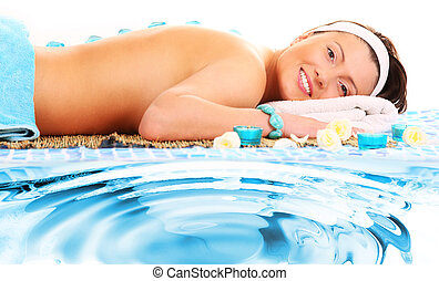 Spa treatment - A picture of a young beautiful woman having...