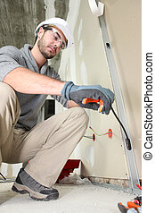 Electrician working on electrics