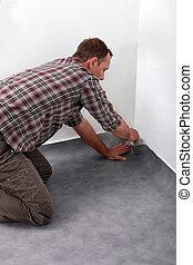 hombre, colocar, alfombra