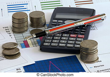 Financial planning - Calculator, pen and cooins on sheet of...