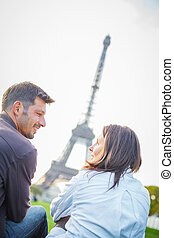 Young romantic couple sitting in Paris - Young romantic...