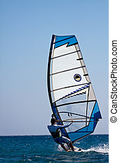 Rear view of young windsurfer - Rear view of man windsurfing...