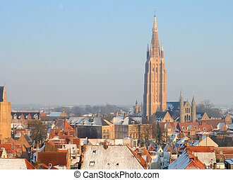 Church of Our Lady and roofs in winter in Bruges, Flanders,...