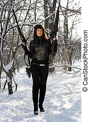 Armed pretty young woman