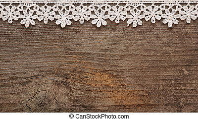wooden background with white lace frame