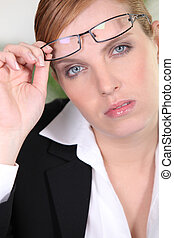 Red-haired businesswoman wearing glasses