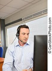 Office worker wearing a headset