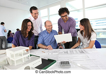 People working in an architect's office
