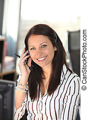 Smiling woman with a telephone headset