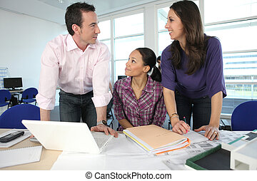 Colleagues working together in the office