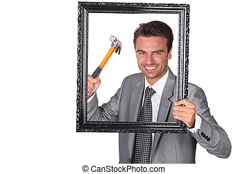 Aggressive businessman with picture frame