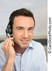 Man using a telephone headset