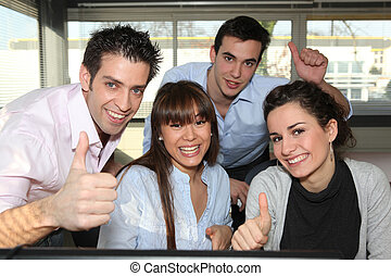 Office workers giving a thumbs up